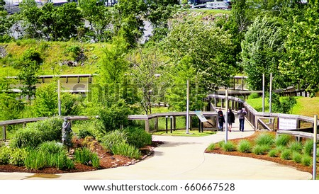 April 29 2017 Little Rock Arkansas A family walking through a park on the grounds of