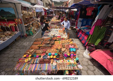 April 29, 2017 Otavalo, Ecuador: indigenous quechua people selling artisan gifts on stands set up on the street in the Saturday market