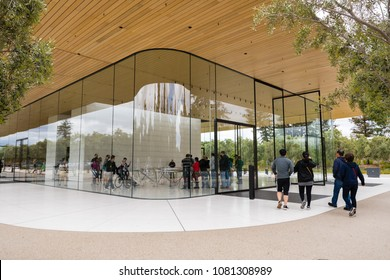 April 29, 2018 Cupertino / CA / USA - Exterior view of the new and modern Apple Park visitor center located next to their new corporate offices in Silicon Valley, south San Francisco bay area