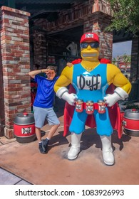 APRIL 29, 2018 - ORLANDO, FLORDIA: ELEVEN YEAR OLD BOY AND DUFFMAN FROM THE SIMPSONS AT UNIVERSAL STUDIOS.