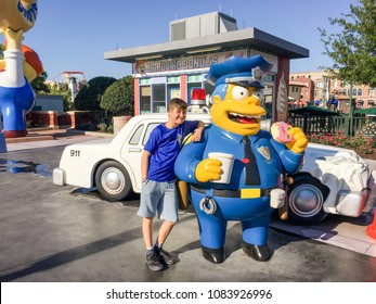 APRIL 29, 2018 - ORLANDO, FLORDIA: ELEVEN YEAR OLD BOY AND CHIEF WIGGUM FROM THE SIMPSONS AT UNIVERSAL STUDIOS.