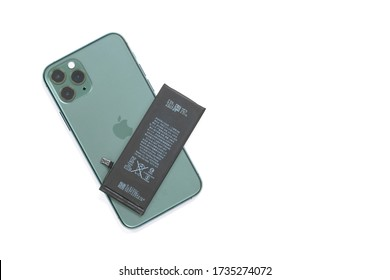 April 29, 2020, Rostov, Russia: Apple iPhone 11 Pro model midnight green color, with three cameras on the back side and lithium battery above. Replacing the old damaged battery in your smartphone.