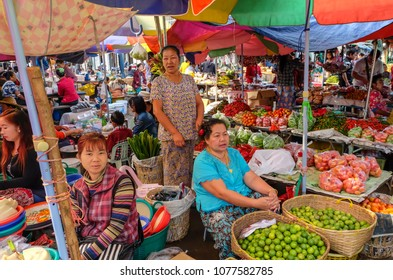 April 3 2017 - Kyaing Tong, Myanmar. Women selling fruit and vegetables  in the market