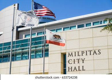 April 30, 2017 Milpitas/CA/USA - The City Hall Building on a sunny spring day; the City of Milpitas, USA and the State of California flags blowing in the wind