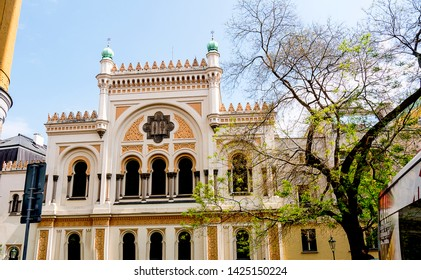 April 30 2019 The Spanish Synagogue in the Jewish Quarter  in Prague the Capital of the Czech Republic with the statue to Franz Kafka. This is on the edge of the Josefov Quarter of Prague