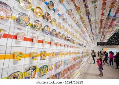 April 4, 2016 Osaka, Japan - Little girl look up many cup noodles decoration on wall exhibition tell story aboout instant noodles at The Cup Noodles Museum Osaka.