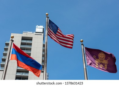 April 4, 2019-New York, NY/USA: American flag  flanked on either side by Armenia's new flag (left) and the Armenian Apostolic Church's flag (right), both respectfully positioned lower than USA flag.