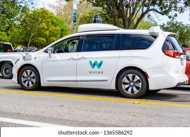 April 6, 2019 Mountain View / CA / USA - Waymo self driving car performing tests on a street near Google's headquarters, Silicon Valley