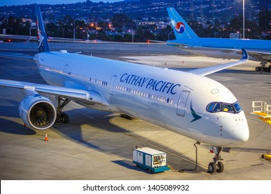 April 6th, 2019. San Francisco, California. A Cathay Pacific A350-900 parked on the tarmac awaiting to be towed to the gate for a flight to Hong Kong.