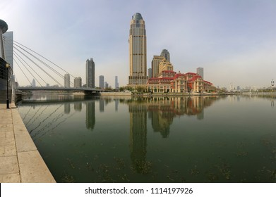 April 8, 2017, China, Tianjin. Beautiful view of the city of Tianjin by the Haihe river with the reflection of buildings in the water
