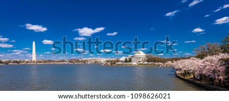 APRIL 8, 2018 - WASH DC - Jefferson Memorial & Washington Monument, Tidal Basin, Washington D.C. feature Cherry Blossoms