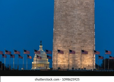 APRIL 8, 2018 WASHINGTON D.C. - US Flags with cropped view of US Capitol and Washington Monument surrounded by visitors to Washington, D.C.