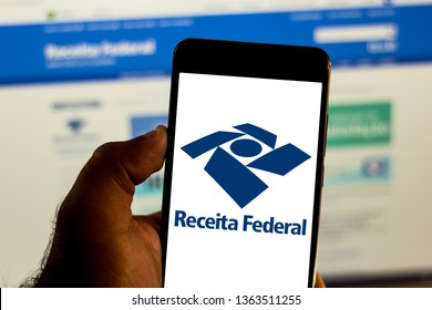 April 8, 2019, Brazil. Logo of the Receita Federal do Brasil in the mobile device. Concept of income tax, economy, interest, taxes and dividends.