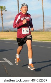 April 9, 2016:Photo of runner running in the Menifee Half Marathon & 5K, which is in Menifee California USA