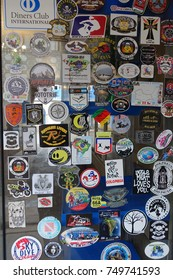 April 9, 2017, Cuzco Peru, Stickers on a Window in the Plaza de Armas