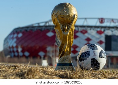 April 9, 2018 Moscow, Russia Trophy of the World Cup and official ball of FIFA World Cup 2018 Adidas Telstar 18 against the backdrop of the Spartak stadium, where the World Cup 2018 matches will be he