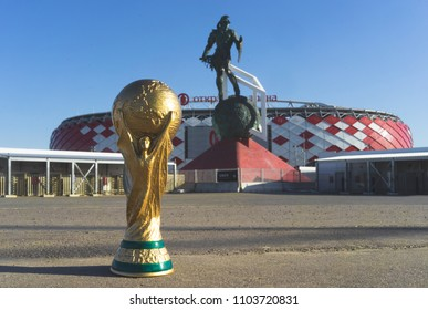 April 9, 2018 Moscow, Russia Trophy of the FIFA World Cup  against the backdrop of the Spartak stadium, where the World Cup 2018 matches will be held.