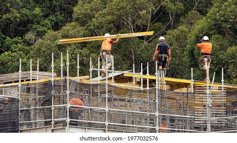 April 9, 2021. Construction progress. Workers installing concrete floor formwork on new home units development at 56-58 Beane St. Gosford.  Australia. Commercial use image.