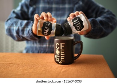 April Fool's Day, April 1, a child and a cup of coffee with pepper and salt. Real kitchen, joke