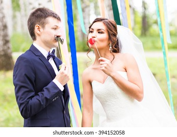 April Fools' Day. Wedding couple posing with mask.