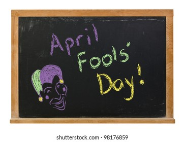 April Fools' Day written in colorful chalk on a chalkboard along with a sketch of a jester