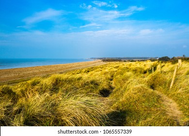 An April walk along the coast and sand dunes of Climping beach in west Sussex south east England