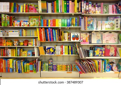 Aprilia, Italy: Circa Aug 2013 - Shelf full of colorful children fairy books in bookshop at Aprilia2 Mall, Rome, Italy