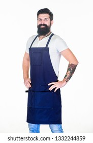 Apron for true guy at the grill. Master of grill in cooking apron with pockets. Bearded man in kitchen apron. Stylish grill cook keeping hands on hips. Cook with long beard wearing bib apron.