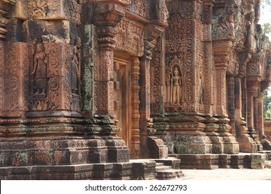 Apsara dancer on walls of intricate temple at  Banteay Srei, Cambodia