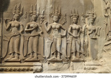 Apsara dancer statues carved into wall of gallery,  Angkor Wat,  Cambodia