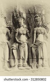 Apsara dancers decorate the interior courtyard walls of  Angkor Wat,  Cambodia