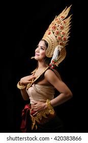 Apsara dancing portrait in studio with black background