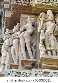 Apsara naked dancers in candid poses; sculpture on Varaha Temple, Khajuraho in  India, Asia