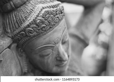 Apsara sandstone sculpture in ancient Khmer rock castle according to the belief of Hindu Brahman in Cambodia, Thailand, Laos, India, Sri Lanka, Nepal, East Asia.