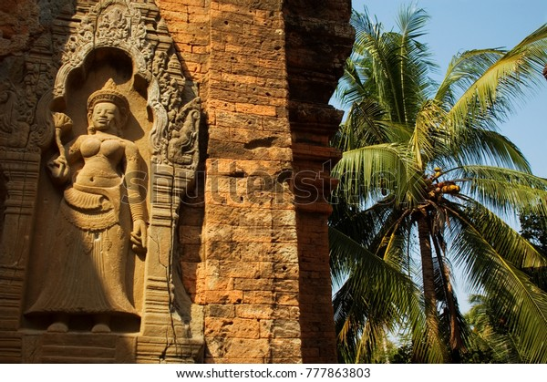 Apsara statue on exterior of a temple within the Roluous group at Angkor, Siem Reap, Cambodia