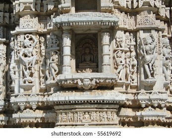 Apsaras, dancing girls and Jain saints on exterior walls of Parasvanth temple  at Ranakpur in Rajasthan, India