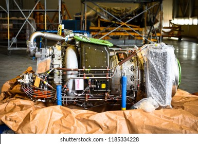 APU means auxiliary power unit. It is located on tailend of commercial aircrafts. It is actually a small jet engine. The APU is a small jet engine the larger jet engines.