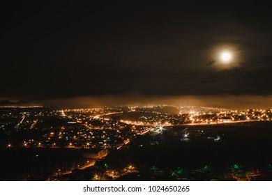 Apucarana, Parana, Brazil, 10/25/2017. The moon illuminating the city.
