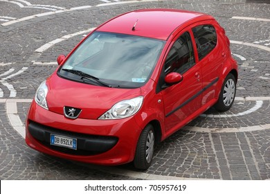 APULIA, ITALY - JUNE 6, 2017: Peugeot 107 red city car parked in Italy. There are 41 million motor vehicles registered in Italy.