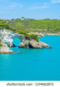 Apulia, Italy: View of the Arco di San Felice, caves and beach, south of Vieste