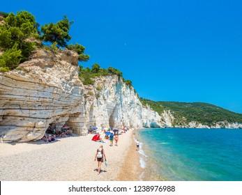 APULIA, IT - Jul 19, 2018: Mattinata Faraglioni stacks and beach coast of Baia Delle Zagare, Vieste Gargano, Apulia, Italy