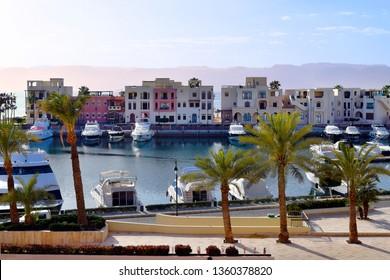 AQABA, JORDAN - MARCH 04: Marina and buildings from Tala Bay resort on Red Sea, in background mountains of Sinai peninsula, on March 04, 2019 in Aqaba, Jordan