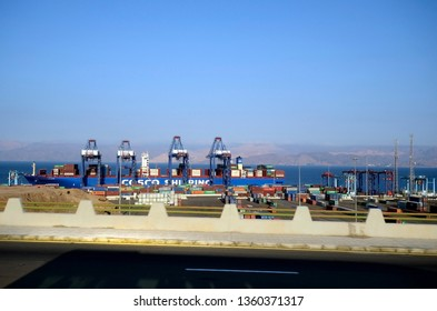 AQABA, JORDAN - MARCH 06: Container terminal on Red Sea with container ship equipment and cranes, on March 06, 2019 in Aqaba, Jordan