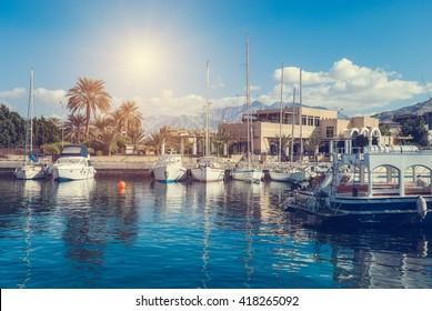 Aqaba, Jordan - November 22, 2007: Yachts and ships in marina of Aqaba, Jordan southernmost city, popular resort, located at the northern tip of the Red Sea at November 22, 2007. Aqaba, Jordan