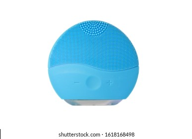 Aqua blue silicone face cleansing brush isolated on white. Brushes for skin treatments. Cosmetic procedure. First step, skin cleaning. Peeling and gently rubbing face. Copy space, design space. - Shutterstock ID 1618168498