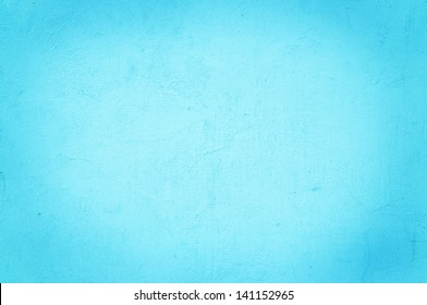 Aqua color on a solid stone wall as background texture.