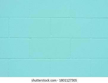 Aqua colored concrete wall background