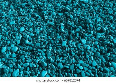 Aqua colored stones of the beach of Aphrodite. Souvenirs as a gift. The rock of the Greek (Petra tou Romiou). Paphos region. Cyprus island. Background