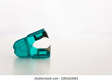 aqua colored Transparent Stapler remover. isolated on a white background. copy space available