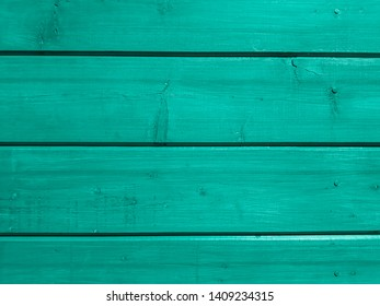 Aqua painted boards of an old village house. Texture and Background
